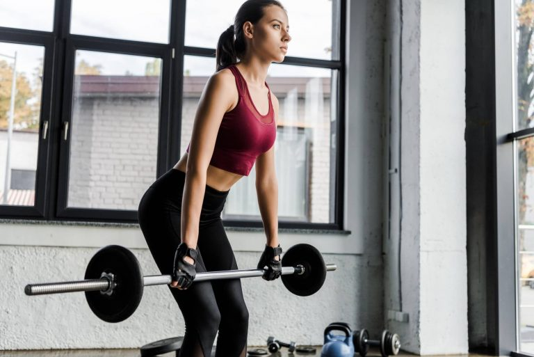 beautiful-determined-sportswoman-in-weight-lifting