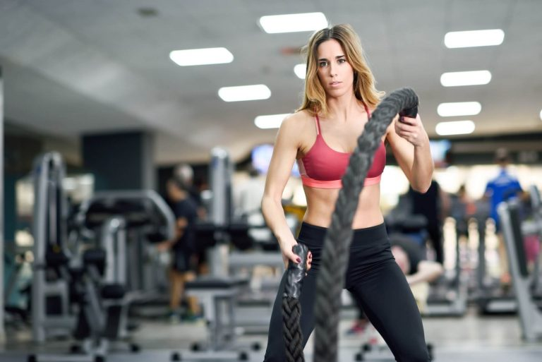 woman-with-battle-ropes-exercise-in-the-fitness-gym